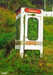 Telephone booth in Sweden  by John R Kjellstrm