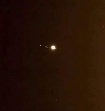 Telescope view of Jupiter and its Galilean moons