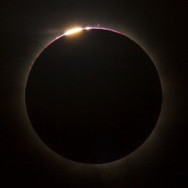 Telescopic snapshot from Queensland AU captures total solar eclipse and the rare Bailys Beads when sunlight streams through crevices and is blocked by mountains on the Moons rough surface