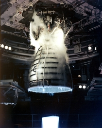 Test firing photo of Space Shuttle main engine The liquid-fueled cryogenic rocket engine produces a blue flame from the bell-shaped nozzle also called the mach diamond