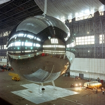 Test inflation of the  ft diameter PAGEOS satellite in a blimp hangar  Once in orbit it was tracked visually as part of an early experiment in global positioning Sightings of the balloon satellite were used to pinpoint a position on the earths surface to
