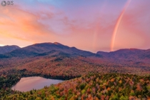 Thanks to a rainbow and peak fall foliage this is easily the best sunrise I have ever seen in my life Adirondacks NY