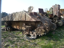 The abandoned and rusting hull of a Sherman tank