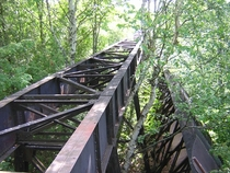 The abandoned railway bridge across the top of the Redridge Steel Dam