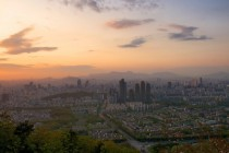 The affluent Gangnam district and beyond the rest of Seoul just before sunset seen from the peak of Mt Guryongsan