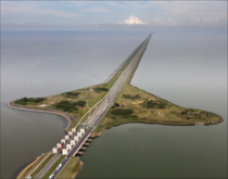 The Afsluitdijk English Closure Dike is a km mi long major causeway in the Netherlands and a fundamental part of the larger Zuiderzee Works Damming off the Zuiderzee a salt water inlet of the North Sea turning it into the fresh water IJsselmeer It opened