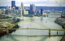 The Allegheny River left and Monongahela River join to form the Ohio River at Pittsburgh Pennsylvania the largest metropolitan area on the river
