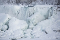 The almost frozen Niagara Falls  Photo by Lindsay DeDario xpost from rTrueNorthPictures