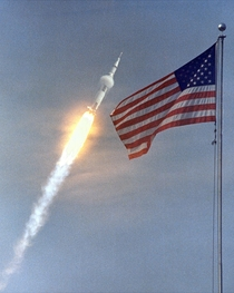 The American flag heralds the flight of Apollo  the first Lunar landing mission The Apollo  Saturn V space vehicle lifted off with astronauts Neil A Armstrong Michael Collins and Edwin E Aldrin Jr at  am on July   from Kennedy Space Centers Launch Complex