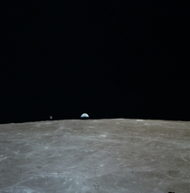 The Apollo  Command Module Casper and the Earth as viewed from the Lunar Module Orion