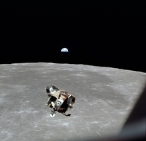The Apollo  Lunar Module approaching the Command Service Module with an Earth rise for good measure