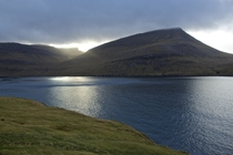 The Autumn sun peaking through the mountains on Vgar in The Faroe Islands