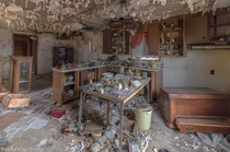 The badly decaying kitchen in an abandoned house in Ontario Canada OC