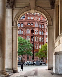 The baroque Midland Hotel from underneath the arches of the Town Hall extension Manchester England