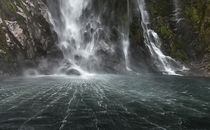 The base of Stirling Falls at Milford Sound South Island New Zealand