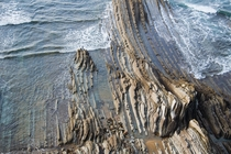 The beaches around North Bilbao Spain have beautiful sedimentary rocks that emerge from the sea