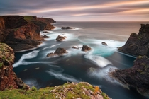 The beautiful coastline of Shetland islands in Scotland during susnet