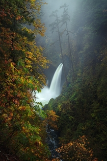 The beautiful Metlako Falls located in the Columbia River Gorge in Oregon on a rainy and foggy fall morning - taken Saturday