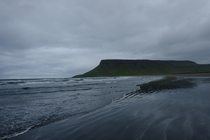The black beach on an ominous day Iceland   X