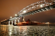The Blatnick bridge and frozen Duluth MN Harbor with the bargetug combo Joyce Van EnkevortGreat Lakes Trader