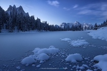The blue hour on frozen Lake Antorno under the Dolomites  Photo by Nicola Bombassei xpost from rItalyPhotos