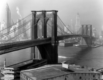 The Brooklyn Bridge arches toward Lower Manhattan  by Andreas Feininger