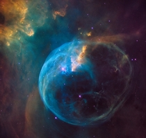 The Bubble Nebula an enormous bubble being blown into space by a super-hot massive star Its seven light-years across - about one-and-a-half times the distance from our sun to its nearest stellar neighbor Alpha Centauri