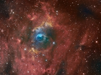 The Bubble Nebula NGC  which contains a hot O-star x larger than our sun near its center