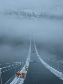 The building of Hardanger Bridge in Norway photo by uJunkDeluxe
