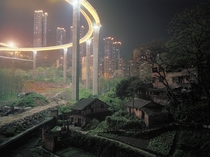 The Caiyuanba Bridge completed in  contrasts with the more rural outskirts of Chongqing China Mark Horn