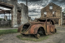 The car of Dr Desourteaux in Oradour-sur-Glane France  by Mike Stuckley