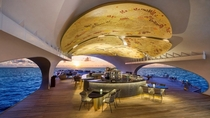 The ceiling of the Whale Bar at the St Regis Vommuli Resort in Maldives adorned with a work that incorporates pyrography a traditional Maldivian art form