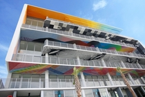 The ceilings above the balconies of this building are each painted so the art can be enjoyed by people on the street Located in the Wynwood Arts District in Miami Florida and designed by architectural firm DFA the owners expect to change the art every few