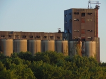 The Central Soya Plant stands alongside the Tennessee River in Chattanooga Tennessee I took this picture last year while on a riverboat cruise Can you spot the guy standing on top of the building
