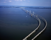 The Chesapeake Bay Bridge officially named the William Preston Lane Jr Memorial Bridge The original span opened in  and at the time it was the worlds longest continuous over-water steel structure The parallel span was added in  by Carol M Highsmith ca
