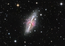 The Cigar Galaxy M lies  million light-years away in the constellation Ursa Major the Great Bear