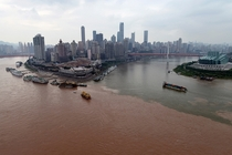 The clear waters of the Jialing River join the muddy floodwaters of the Yangtze River in Chongqing China