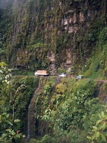 The cliff-hanging Yungas Road at San Pedro waterfall between La Paz and Coroico Bolivia