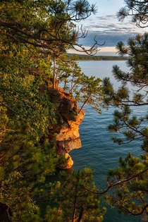 The cliffs of the Apostle Islands National Lakeshore glowing before sunset Wisconsin
