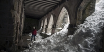 The cloisters at Roncesvalles Church in the Pyrenees mountains after a heavy snowfall  Photo by Alvaro Barrientos xpost from SpainPics