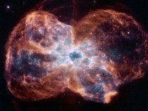The colorful demise of a Sun-like star NGC  - Nebula of the hottest known white dwarf and its debris