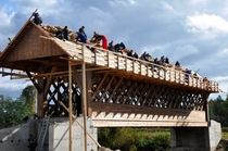 The community constructing some cool new infrastructure Building a covered wooden bridge in Jruska Estonia