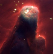The Cone Nebula looks a nightmarish beast raising its head from a crimson sea