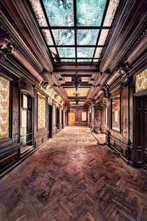 The corridor of a derelict mansion  Photographed by Benjamin Wiessner
