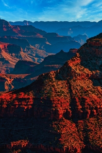 The countless layers of the Grand Canyon on a blue sky day AZ