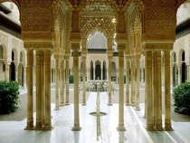 The Courtyard of the Lions at the Palace of the Lions in the Alhambra Granada Spain c-