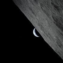 The crescent Earth rises above the lunar horizon taken from the Apollo  spacecraft in lunar orbit during final lunar landing mission in the Apollo program Credits NASA