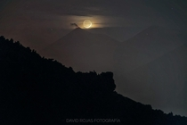 The crescent moon hiding in the volcano of Fuego in Guatemala