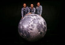 The crew of NASAs Apollo  mission behind a model of the moon in  Photo Ralph Morse