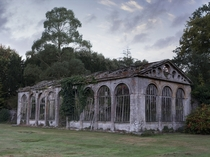 The crumbling remains of a stone orangery Found in the grounds of a magnificent castle Photo by memmett